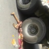 Woman Under Truck Wheels